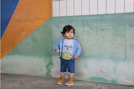 Kids Around (groupe CWF) met en avant la nouvelle collection de textile enfant bio griffée Timberland.