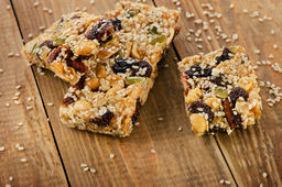 Healthy fruit and nut granola bars on  rustic wooden table. Selective focus