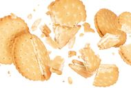 Delicious biscuits crushed into pieces in the air,