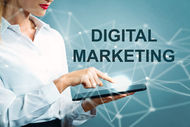 Digital Marketing text with business woman using a tablet