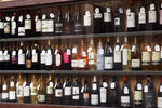 LOGRONO, SPAIN - JUNE 28, 2014: Showcase of alcohol store in Logrono. City is centre trade in Rioja wine, for which the area is noted
