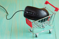 Shopping cart with a computer mouse on blue background